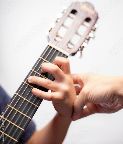 playing the guitar - 303912302