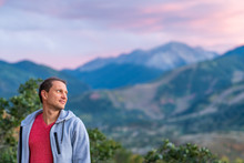 Aspen, Colorado Rocky Mountains Colorful Purple Blue Twilight Sunset Blurry Background View And Young Man Standing Looking