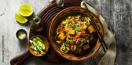 banner of Asian vegan stir fry with tofu, rice noodles and vegetables, top view Wallpaper Mural