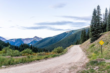 View Of Green Alpine Mountains With Dirt Road Leading To Ophir Pass Near Columbine Lake Trail In Silverton, Colorado In 2019 Summer Morning