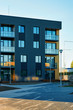 Apartment residential home facade architecture and outdoor facilities. Blue sky on the background.