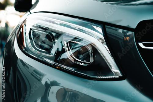 Pinturas sobre lienzo  Detail light close up of on sport car.