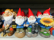 A Shelf Of Garden Gnomes