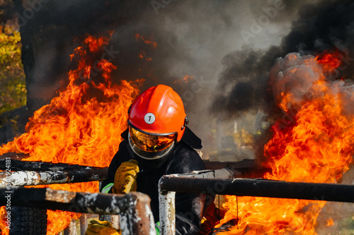 Brave Firefighter fighting a fire, firefighter training
