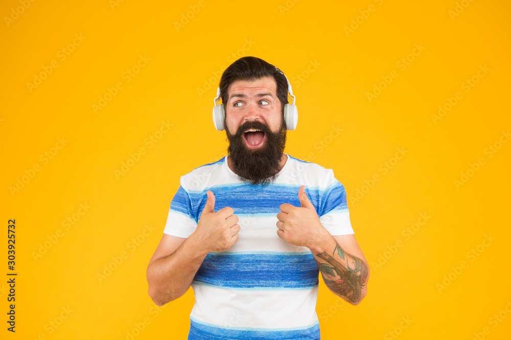 Fototapeta happy bearded meloman headphones. mega hits. summer in the city. free time. Summer playlist. summer music mix. Man hipster listen song yellow background. enjoy summer vacation. Melody for relax