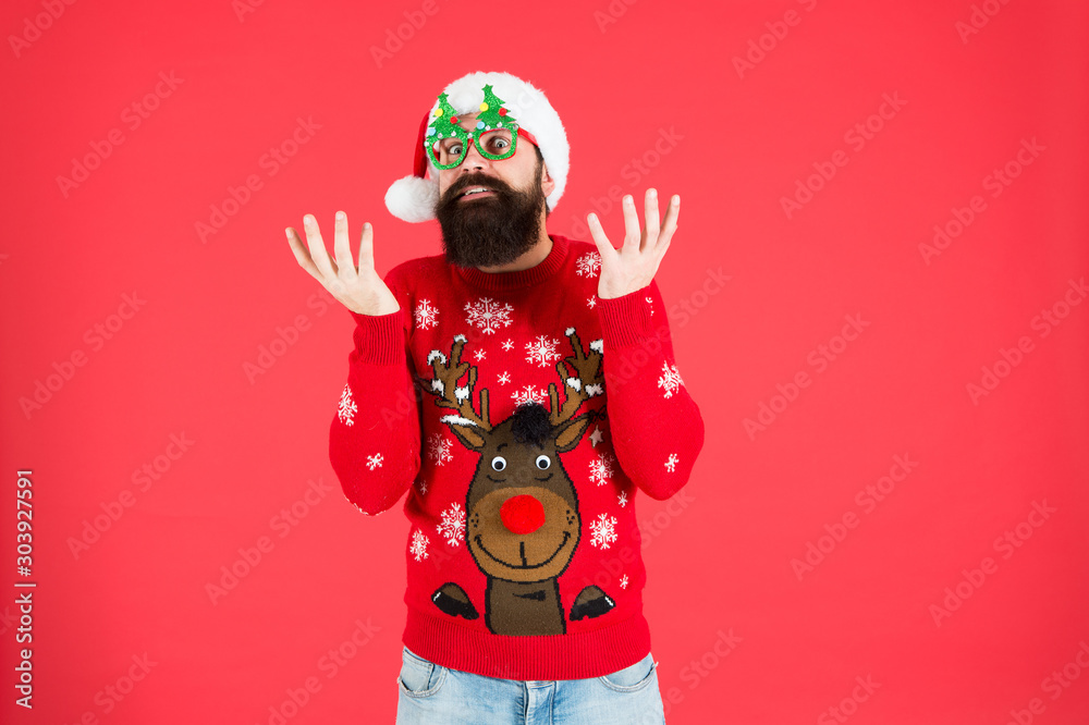 Fototapeta Hipster bearded man wear winter sweater and hat. New year. Knitted sweater. Happy new year. Christmas spirit. Funny outfit. Sweater with deer. Clothes shop. Buy festive clothing. Holidays accessories