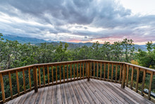 Aspen, Colorado House With View From Wooden Deck In Rocky Mountains Wide Angle View Of Storm Clouds Foreground Of Green Plants In Roaring Fork Valley