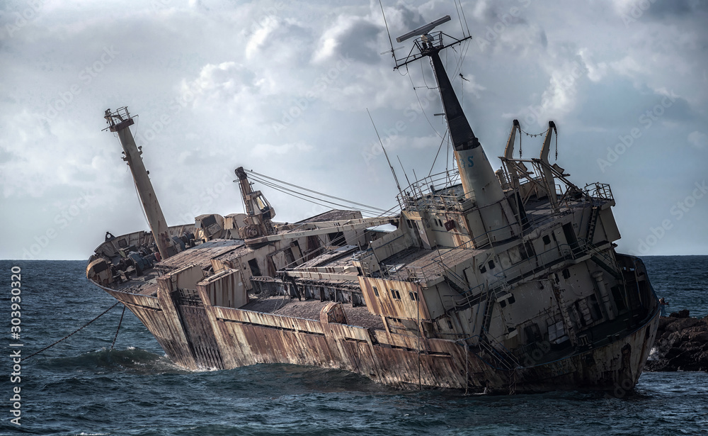 Fototapety, obrazy: Cyprus, Paphos. Shipwreck. The ship crashed on the coastal rocks. Rusty ship at the shore of the Mediterranean sea. Tourist attractions of Cyprus.