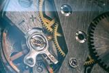 vintage old mechanism with gears and springs, clock mechanism close-up macro