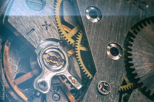 vintage old mechanism with gears and springs, clock mechanism close-up macro - 303933121
