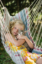 Child And Cat Relaxing Together