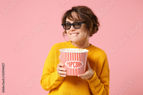 Smiling young woman girl in 3d imax glasses posing isolated on pink background Wallpaper Mural