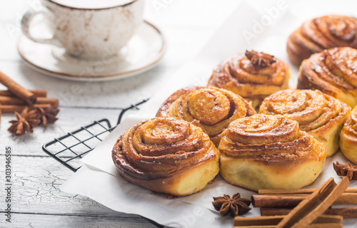 Fototapeta Latte or cacao and Cinnamon Bun for breakfast or break on white background. Cup of coffee and homemade buns obraz