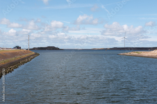 Fototapeta IJmuiden Atlantikwall Forteiland with a Windpark in the background - green renew