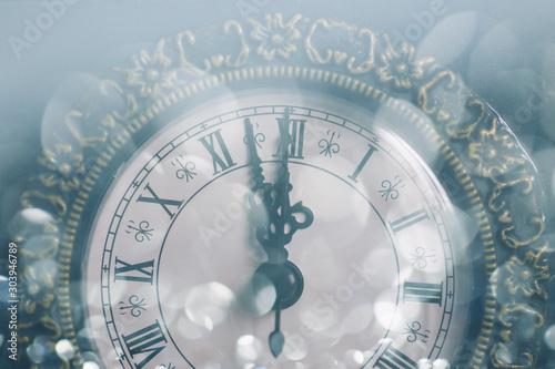 Fotografia Vintage clock pointing 12 o'clock at midnight. New year's eve.