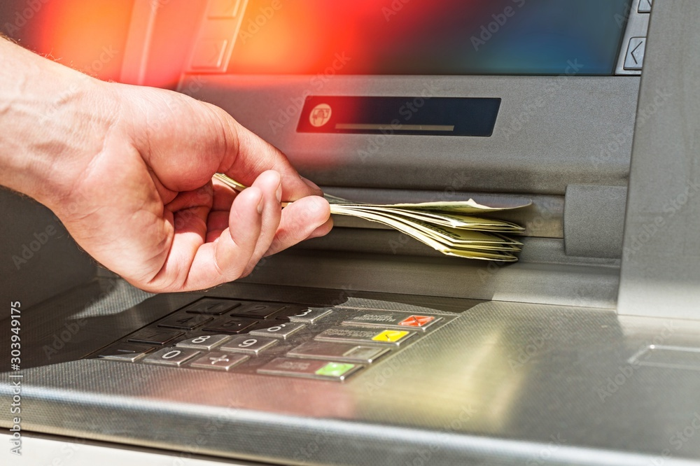 Fototapeta Atm bank banking paper currency bank teller removing currency