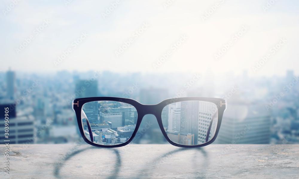 Fototapeta Glasses that correct eyesight from blurred to sharp
