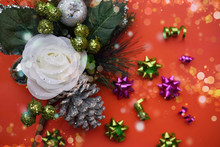 Christmas Orange Background. White Rose, Fruits And Cone. Glowing Backdrop. Blurred Bokeh.