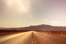 Desolate Desert Road With Moun...