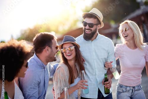 Obraz Group of friends having a party on the beach - fototapety do salonu