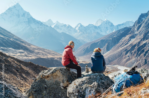 Cute Couple resting on the Everest Base Camp trekking route near Dughla 4620m Wallpaper Mural