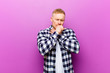 Leinwanddruck Bild - young blonde man with squared shirt feeling ill with a sore throat and flu symptoms, coughing with mouth covered