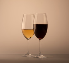 Two Wineglass One Half Full Of...