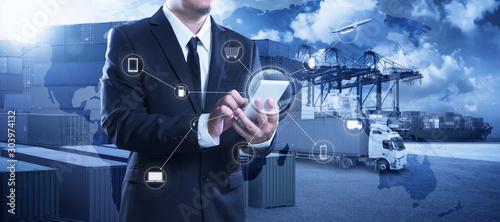 Businessman touching smartphone for analyze stock at logistics port - fototapety na wymiar