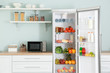 canvas print picture - Open big fridge with products in kitchen