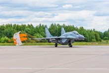 Fighter Combat Aircraft Landed With A Parachute Released At A Military Base.