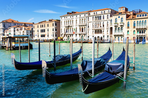 Venetian gondolas moored in Grand Canal
