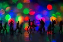 Miniature Toy - A Couple Dancing On The Street  Together Among Busy Commuters Crowd With Colorful Bokeh Lights, Happiness Concept.