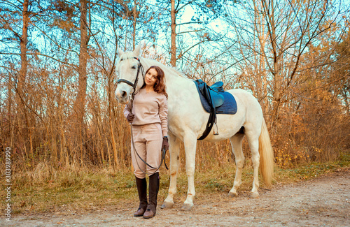 girl riding a white horse in the woods Wallpaper Mural