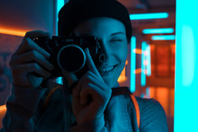 Smiling Female Photographer Us...