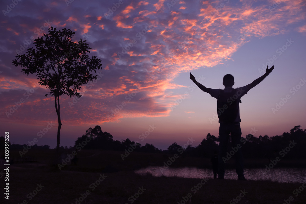 Fototapety, obrazy: silhouette of a man with camera over sunset background,