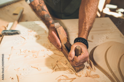 Obraz Portrait of a young male carpenter who works in his workshop. - fototapety do salonu