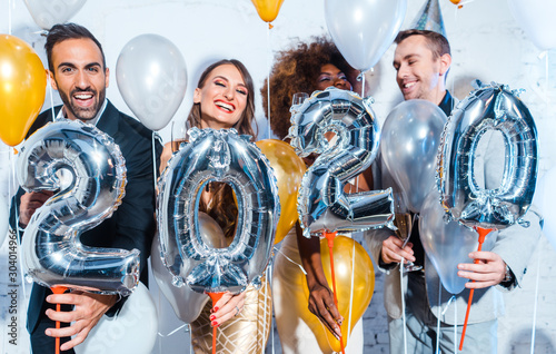 Fotobehang Vrouw gezicht Party people women and men celebrating new years eve 2020