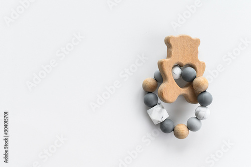 Cute wooden handmade toys for newborn on white background, copyspace Fototapet