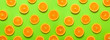 canvas print picture - Many orange slices on color background