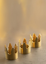Three Gold Crowns On Black Background, Symbol Of Tres Reyes Magos  ( Three Wise Men) Who Come Bringing Gifts For The Kids On Epiphany Or Dia De Reyes Magos.