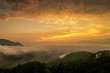 Mountain view misty morning above Kok river and Tha Ton city in valley around with sea of mist with cloudy sky background, sunrise at Wat Tha Ton, Fang, Chiang Mai, northern of Thailand.