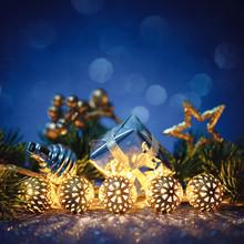 Christmas Gold Garland With Fir Tree On Blue Glitter.