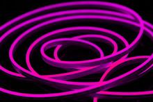 Purple Flexible Led Tape Neon Flex On Black Background.