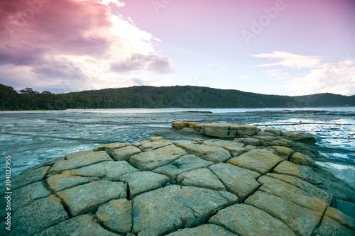 Foto op Plexiglas Purper Rocky beach at sunset in Tasmania, Australia