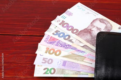 Fotografie, Obraz  Ukrainian money in the black wallet
