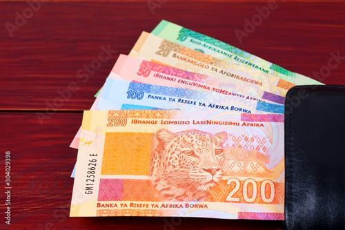 Obraz na plátně  South African money in the black wallet
