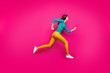 Leinwanddruck Bild - Full length body size photo of pretty cute nice sweet girl running towards shopping senter in footwear yellow pants isolated vivid color pink background