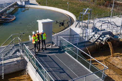 Cuadros en Lienzo Engineers assesing waste treatment plant with drone