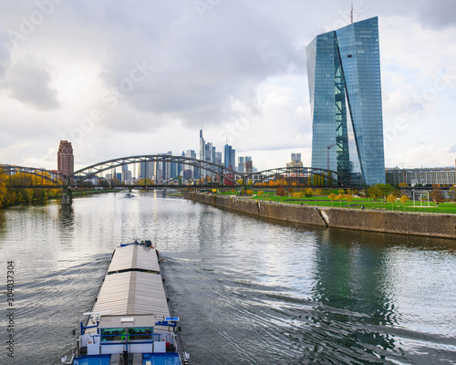 Tela River transport by barge in Frankfurt am Main with the skyscrapers in the backgr