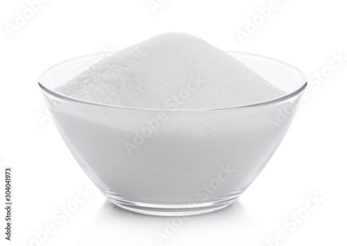 Fototapeta Glass bowl of natural white refined sugar on white background. obraz